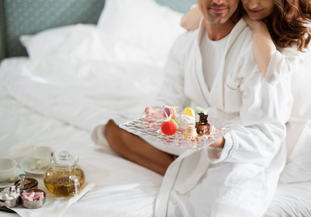 Tea and sweets for breakfast in hotel for loving couple