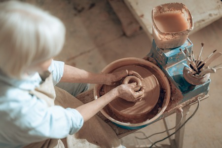 Top view of female potter shaping jug at workshop Stok Fotoğraf