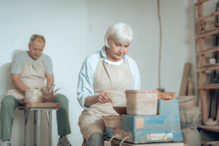 Two potters making earthenware and working in their workshop