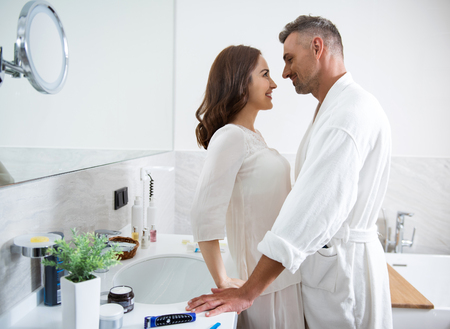 Man and woman looking at each other with love and smiling Stock Photo