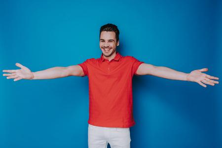 Half length of smiling man posing for camera in studio