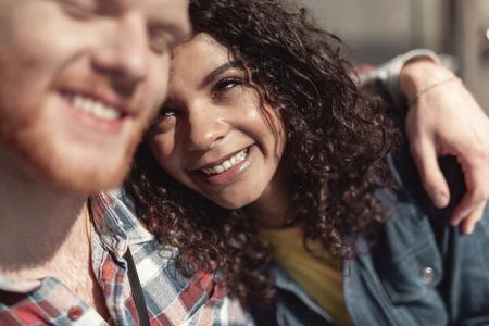Happy girl is enjoying romantic time with boyfriend Imagens