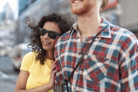 Joyful lady is cuddling young man indoors Imagens