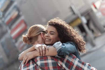 Joyful girl is meeting beloved man in city Banco de Imagens