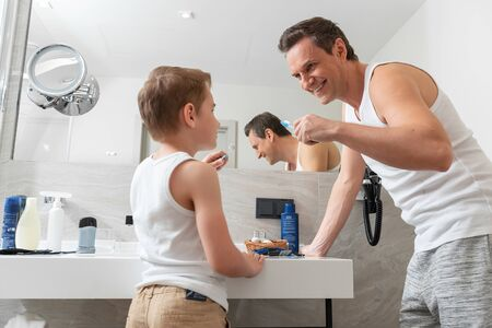 Father and son doing morning procedure together Reklamní fotografie