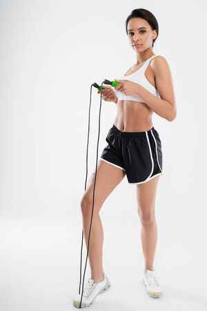 Young athletic lady staying with jumping rope Stock Photo