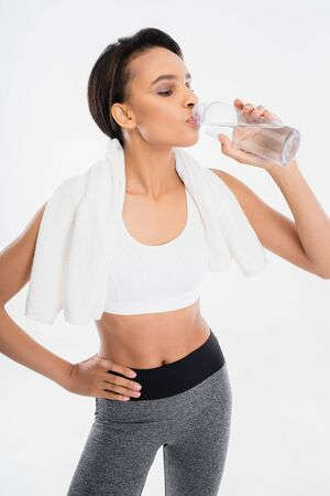 Fitness female drinking clean water after exercise