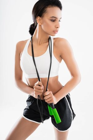 Sportive lady hanging up jumping rope on neck