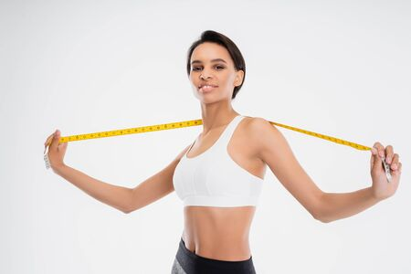 Fitness female with tape measure after exercise Stock Photo