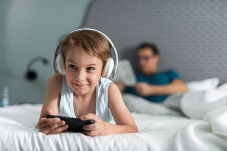 Little boy in headphones listening to music