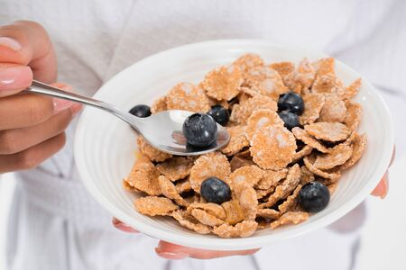 Close up of plate with cornflakes and blueberry Фото со стока
