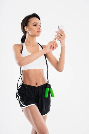 Sportive lady make selfie with jumping rope