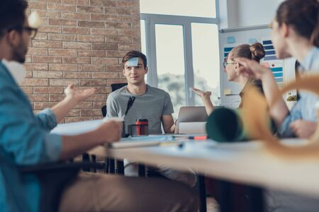 Funny employees enjoying game during break in workroom