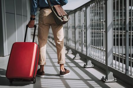 Guy in casual wear walking in airport