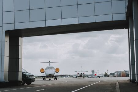 Modern airlines. Aircrafts situating in airport before flight. Travel concept Banco de Imagens