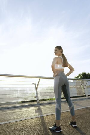 Sportive young lady on morning training outdoor