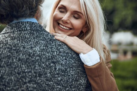 Delighted woman hugging man and laughing stock photo 版權商用圖片 - 128762131