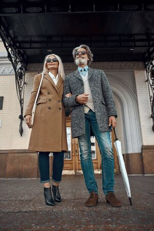 Mature couple ready for walking stock photo