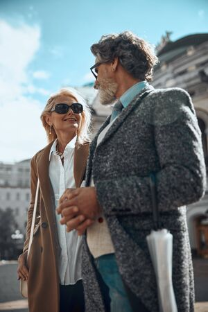 Mature man and woman in coats stock photo 版權商用圖片