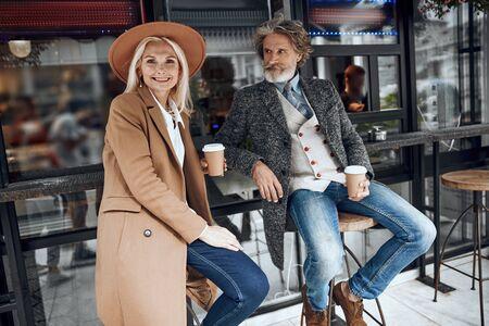 Gladsome couple in the street cafe stock photo 版權商用圖片