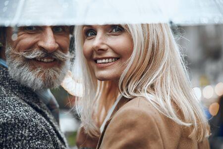Romantic rainy day for happy couple stock photo Imagens
