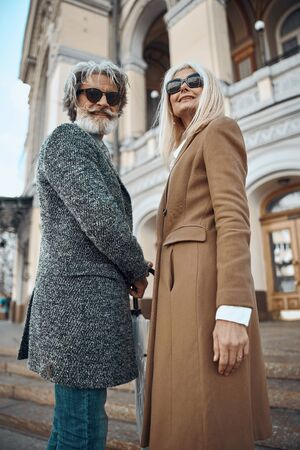 Glad mature man and woman smiling stock photo