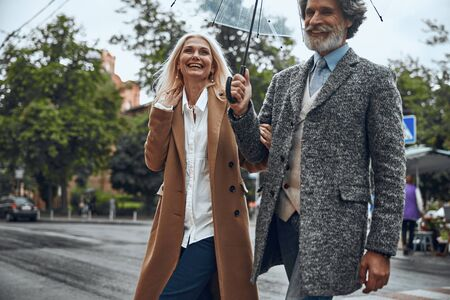 Delighted couple walking and laughing stock photo 版權商用圖片 - 128764143