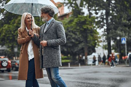 Walking together in any weather stock photo