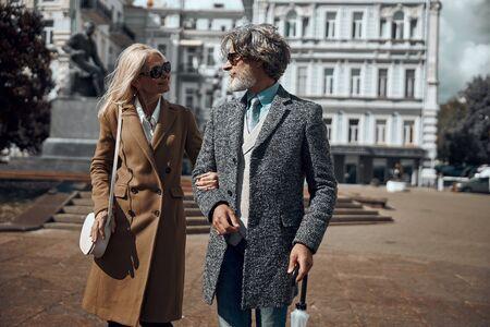 Mature elegant couple walking and smiling stock photo