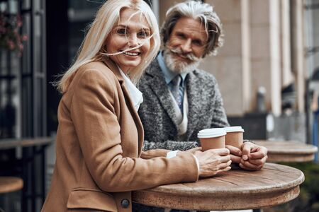 Windy day with coffee to go stock photo