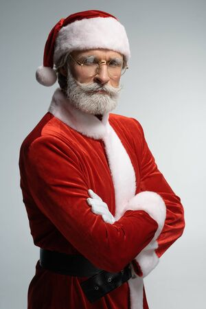 Santa Claus standing with crossed hands on chest Stock Photo - 128766328