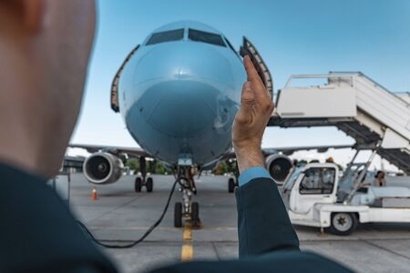 Man taking photos with airplane in airport