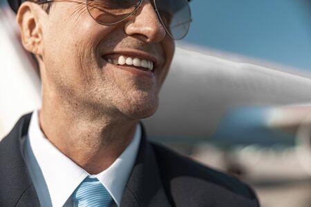 Close up of Caucasian pilot in sunglasses posing for camera
