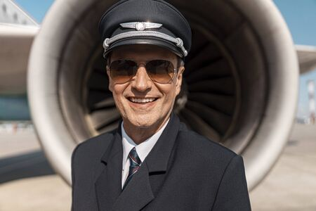 Close up of adult man in uniform looking at camera in airport Stock Photo