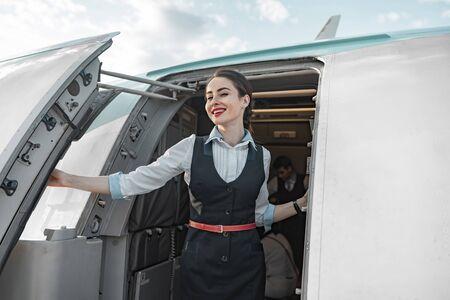 Attractive Caucasian stewardess is on duty on board