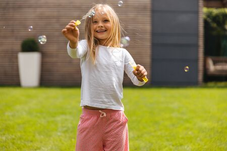 Happy childhood with soap bubbles stock photo