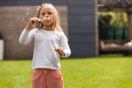 Concentrated child with soap bubbles stock photo