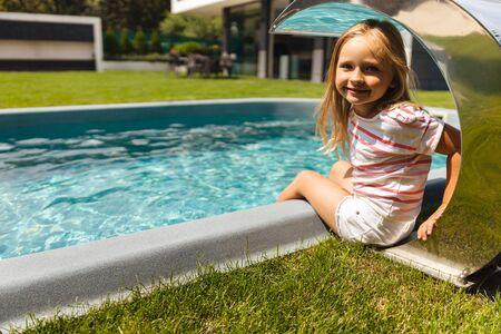 Joyful girl by the pool stock photo Stok Fotoğraf