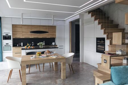 Modern kitchen with stairs to the second floor stock photo