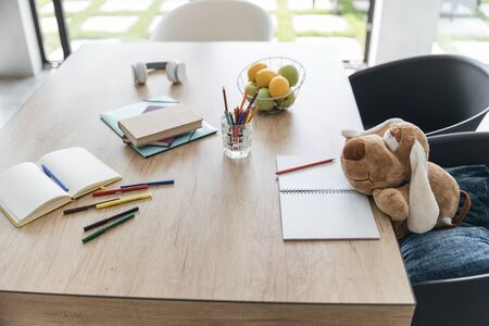 Toy dog making notes at the table stock photo