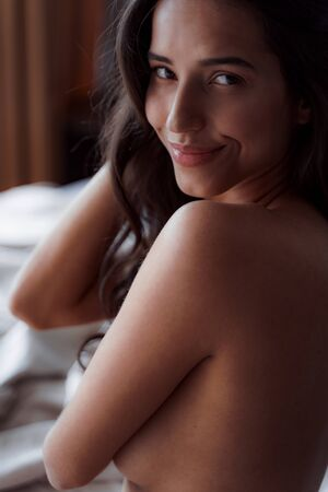 Woman feeling refreshed by sleep in the morning Banco de Imagens - 129525433