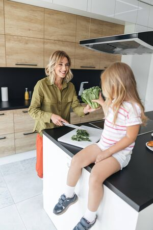 Mother and daughter making salad stock photo Stok Fotoğraf