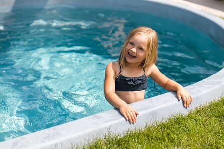 Feeling happy after swimming in pool stock photo