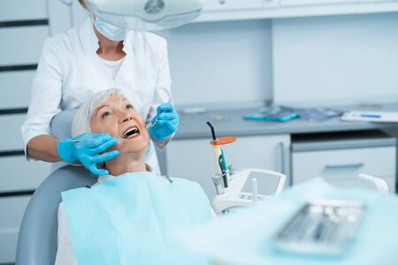 Adult female having a checkup at the dentist Stock Photo
