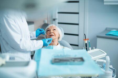 Ault woman ishaving a checkup at the dentist Stock Photo