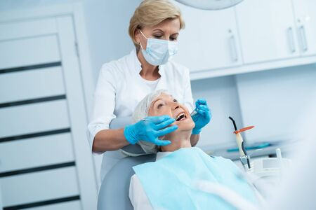 Doctor giving her mature patient a checkup