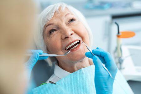 Close up of adult woman having checkup at dentist