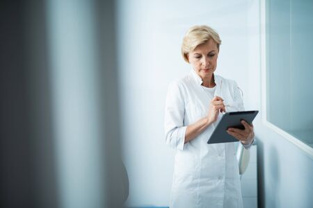 Female doctor is using tablet in office