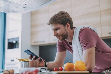 Serious man going to prepare his dinner Stock Photo