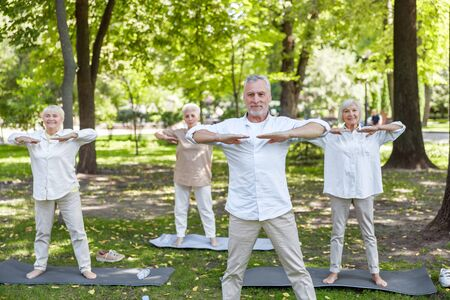 Joyful old people practicing qigong in the park